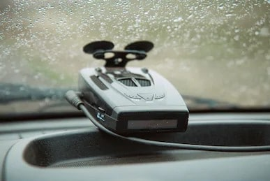 a picture of radar detector mounted low on the windshield
