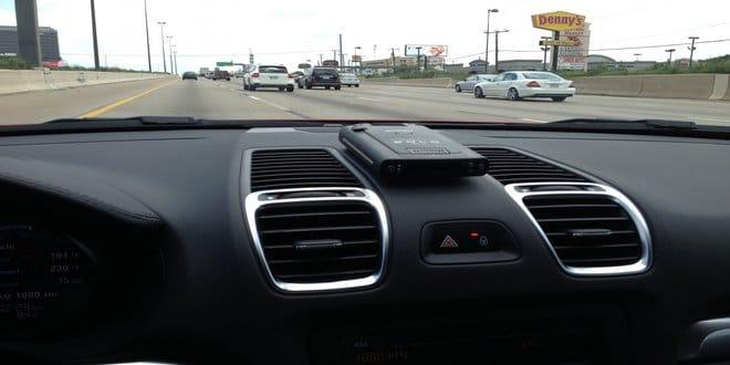 cordless radar detector on the dashboard