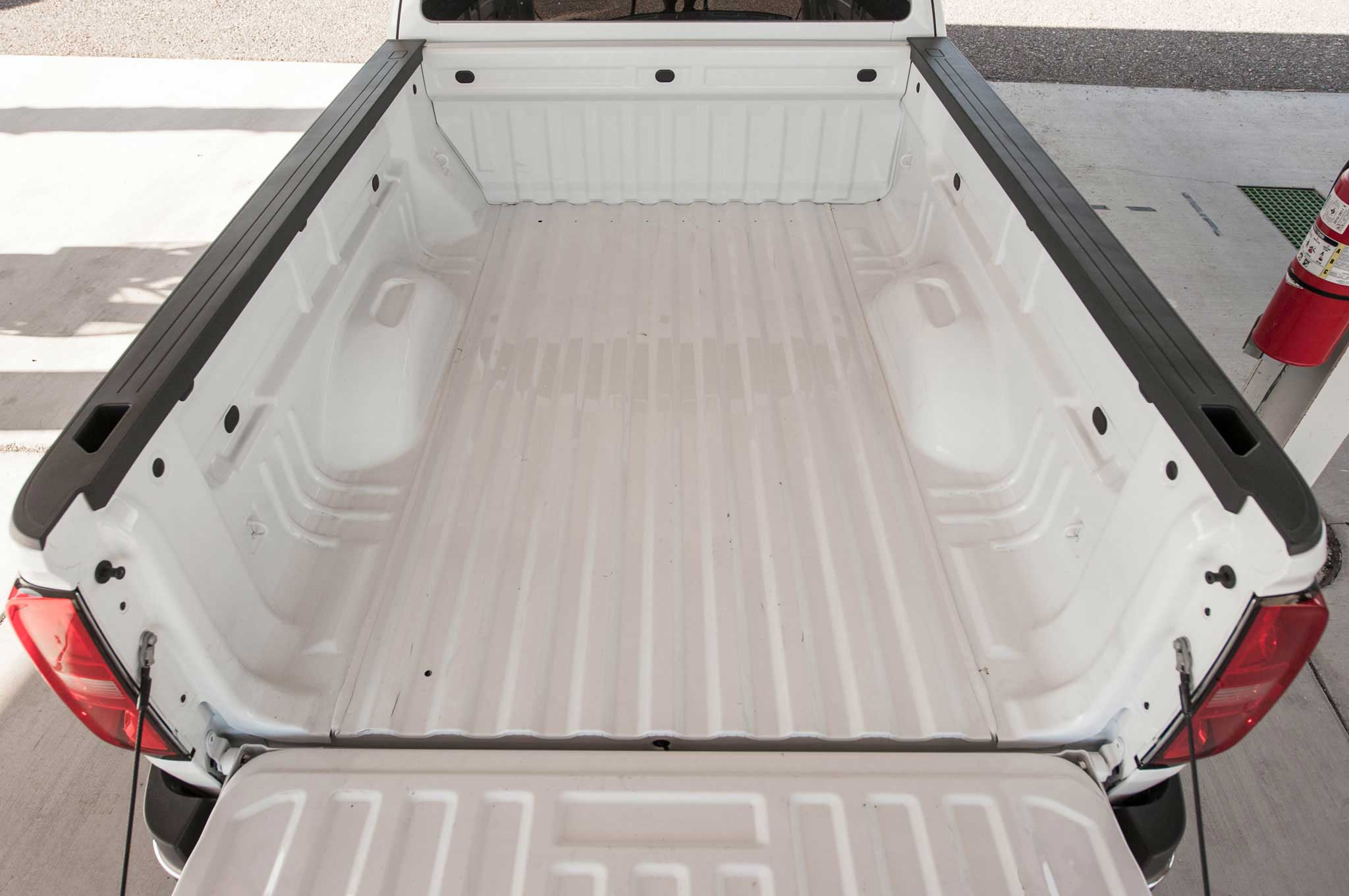 A photo of Chevy Colorado truck bed with a white bedliner