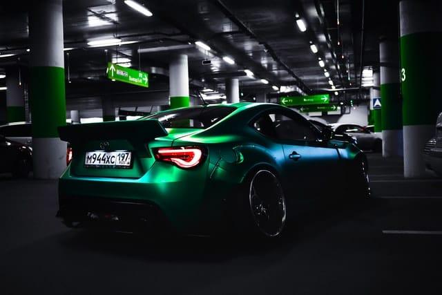 green car inside parking area