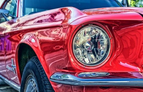 a red Ford car in close-up