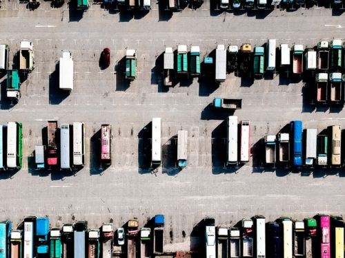 aerial shot of trucks lined up