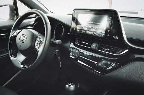 black and white photo of the inside of a Toyota car
