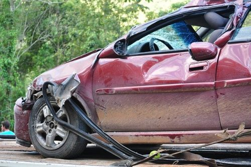 damage on a red car that crashed