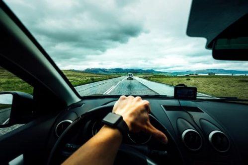 hand maneuvering the car wheel