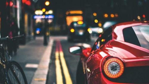 red sports car on the road