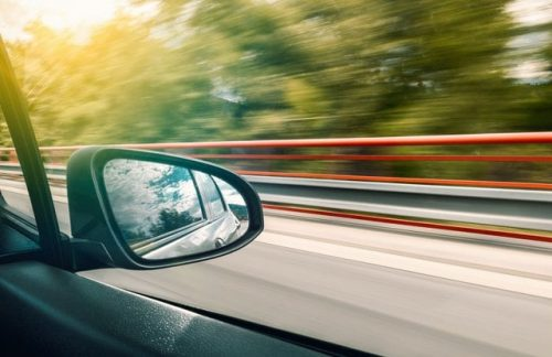 side mirror of a moving vehicle