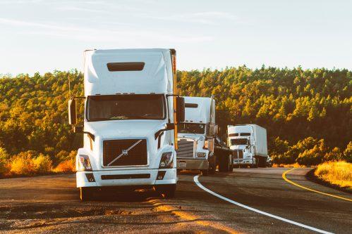 white trucks on the road